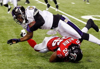 ATLANTA, GA - SEPTEMBER 01:  Kamaal McIlwain #26 of the Atlanta Falcons tackles Marcus Smith #11 of the Baltimore Ravens at Georgia Dome on September 1, 2011 in Atlanta, Georgia.  (Photo by Kevin C. Cox/Getty Images)