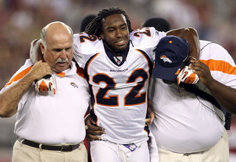 GLENDALE, AZ - SEPTEMBER 01:  Cornerback Syd'Quan Thompson #22 of the Denver Broncos is helped off the field by trainers after an injury against the Arizona Cardinals during the preseason NFL game at the University of Phoenix Stadium on September 1, 2011