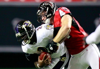 ATLANTA, GA - SEPTEMBER 01:  Kroy Biermann #71 of the Atlanta Falcons sacks Tyrod Taylor #2 of the Baltimore Ravens at Georgia Dome on September 1, 2011 in Atlanta, Georgia.  (Photo by Kevin C. Cox/Getty Images)