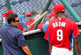 PHILADELPHIA, PA - JULY 29:  General manager Ruben Amaro, Jr. talks to Domonic Brown #9 of the Philadelphia Phillies during batting practice prior to their game against Pittsburgh Pirates at Citizens Bank Park on July 29, 2011 in Philadelphia, Pennsylvani