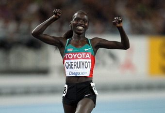 DAEGU, SOUTH KOREA - AUGUST 27:  Vivian Jepkemoi Cheruiyot of Kenya celebrates as she crosses the finish line to win the women's 10,000 metres final during day one of the 13th IAAF World Athletics Championships at the Daegu Stadium on August 27, 2011 in D