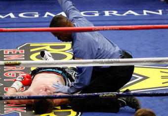 LAS VEGAS - MAY 02:  Ricky Hatton of England lays on the mat as referee Kenny Bayless calls the fight after Hatton was knocked out by Manny Pacquiao of the Philippines during their junior welterweight title fight at the MGM Grand Garden Arena May 2, 2009