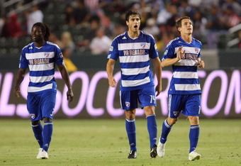 CARSON, CA - JUNE 18:  (L-R) Ugo Ihemelu #3, George John #14 and Zach Loyd #29 of FC Dallas jog to midfield after teammate Jackson Goncalves #6 (not in photo) scored in the second half to put Dallas up 2-1 in their MLS match at The Home Depot Center on Ju
