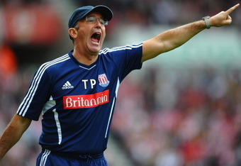STOKE ON TRENT, ENGLAND - AUGUST 14:  Tony Pulis the Stoke manager reacts to events on the field during the Barclays Premier League match between Stoke City and Chelsea at the Britannia Stadium on August 14, 2011 in Stoke on Trent, England.  (Photo by Lau