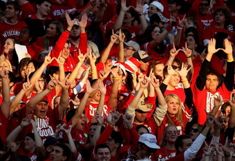 MADISON, WI - OCTOBER 16: Student fans of the Wisconsin Badgers make the 'W' sign with their hands before a game against the Ohio State Buckeyes at Camp Randall Stadium on October 16, 2010 in Madison, Wisconsin. Wisconsin defeated Ohio State 31-18. (Photo