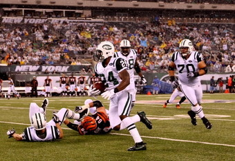 EAST RUTHERFORD, NJ - AUGUST 21:  Darrelle Revis #24 of the New York Jets returns an interception against the Cincinnati Bengals during their pre season game on August 21, 2011 at the New Meadowlands Stadium in East Rutherford, New Jersey.  (Photo by Al B