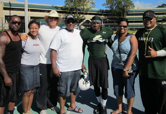 Mike Edwards with his family from left to right, Rick (uncle), Felicia (aunt), coach Miano, Mike Sr. (father), Tameeka (mother), coach Tuioti.