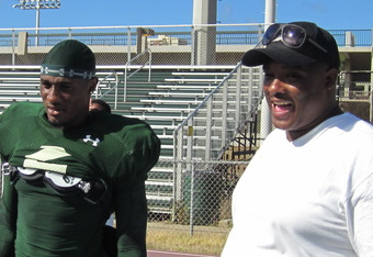 Mike Edwards and his father, Mike Sr., share a laugh after practice on August 31, 2011.