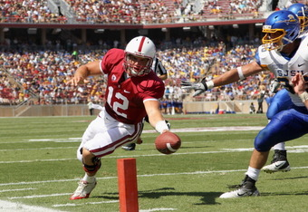 STANFORD, CA - SEPTEMBER 03:  Andrew Luck #12 of the Stanford Cardinal runs in for a touchdown during the first quarter of their game against the San Jose State Spartans at Stanford Stadium on September 3, 2011 in Stanford, California.  (Photo by Ezra Sha