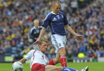 GLASGOW, SCOTLAND - SEPTEMBER 03:  Kenny Miller of Scotland and Jan Rajnoch of Czech Republic during the UEFA EURO 2012 Group I Qualifying match between Scotland and Czech Republic at Hampden Park on September 03, 2011 in Glasgow, Scotland. (Photo by Mark