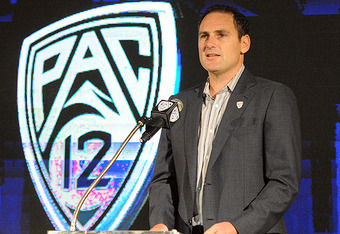PAC 12 commissioner Larry Scott.  He may be redesigning his conference logo yet again.
