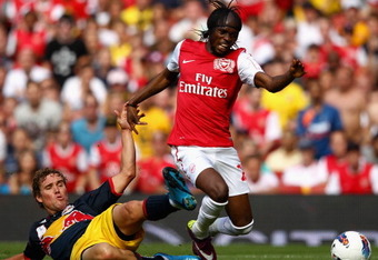 LONDON, ENGLAND - JULY 31:  Gervinho of Arsenal is tackled by Chris Albright of New York Red Bulls during the Emirates Cup match between Arsenal and New York Red Bulls at the Emirates Stadium on July 31, 2011 in London, England.  (Photo by Richard Heathco