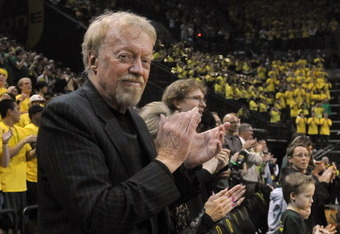 EUGENE, OR - JANUARY 13: Phil Knight, co-founder and Chairman of Nike, Inc., applauds as the teams are introduced before the first game between the USC Trojans and the Oregon Ducks basketball teams at Matt Court on January 13, 2011 in Eugene, Oregon. The
