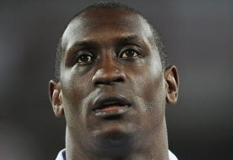 RUSTENBURG, SOUTH AFRICA - JUNE 12:  Emile Heskeyof England stands for the national anthems prior to the 2010 FIFA World Cup South Africa Group C match between England and USA at the Royal Bafokeng Stadium on June 12, 2010 in Rustenburg, South Africa.  (P