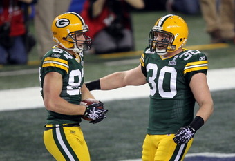 ARLINGTON, TX - FEBRUARY 06: Jordy Nelson #87 and John Kuhn #30 of the Green Bay Packers celebrate after a 29 yard touchdown during Super Bowl XLV at Cowboys Stadium on February 6, 2011 in Arlington, Texas.  (Photo by Mike Ehrmann/Getty Images)