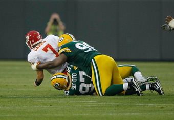GREEN BAY, WI - SEPTEMBER 1: Matt Cassel #7 of the Kansas City Chiefs is sacked by Vic So'oto #97 and C.J. Wilson #98 of the Green Bay Packers during a preseason game at Lambeau Field on September 1, 2011 in Green Bay, Wisconsin. (Photo by Scott Boehm/Get