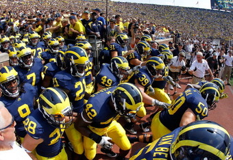 ANN ARBOR, MI - SEPTEMBER 03: The Michigan Wolverines take the field for their 2011 season prior to playing the Western Michigan Broncos  at Michigan Stadium on September 3, 2010 in Ann Arbor, Michigan. (Photo by Gregory Shamus/Getty Images)
