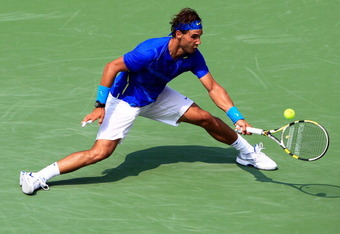 NEW YORK, NY - SEPTEMBER 04:  Rafael Nadal of Spain returns a shot against David Nalbandian of Argentina during Day Seven of the 2011 US Open at the USTA Billie Jean King National Tennis Center on September 4, 2011 in the Flushing neighborhood of the Quee
