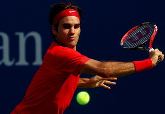 NEW YORK, NY - SEPTEMBER 03:  Roger Federer of Switzerland returns a shot against Marin Cilic of Croatia during Day Six of the 2011 US Open at the USTA Billie Jean King National Tennis Center on September 3, 2011 in the Flushing neighborhood of the Queens