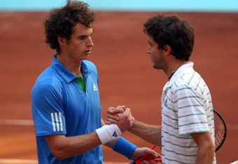 MADRID, SPAIN - MAY 04:  Andy Murray of Great Britain shakes hands with Gilles Simon of France after winning in 3 sets during day five of the Mutua Madrilena Madrid Open Tennis on May 4, 2011 in Madrid, Spain.  (Photo by Julian Finney/Getty Images)