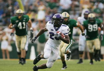 WACO, TX - SEPTEMBER 3:  Running back Aaron Brown #23 of the TCU Horned Frogs carries the ball during the game against the Baylor Bears on September 3, 2006 at Floyd Casey Stadium in Waco, Texas. TCU defeated Baylor 17-7.  (Photo by Ronald Martinez/Getty