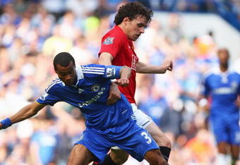 LONDON - SEPTEMBER 21:  Owen Hargreaves of Manchester United tussles with Ashley Cole of Chelsea during the Barclays Premier League match between Chelsea and Manchester United at Stamford Bridge on September 21, 2008 in London, England.  (Photo by Mike He