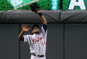 MINNEAPOLIS, MN - AUGUST 26: Austin Jackson #14 of the Detroit Tigers makes a leaping catch in center field against the Minnesota Twins in the fifth inning on August 26, 2011 at Target Field in Minneapolis, Minnesota. The Tigers defeated the Twins 8-1. (P