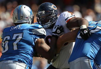 CHICAGO - SEPTEMBER 12: Anthony Adams #95 of the Chicago Bears rushes against Rob Sims #67 and Dominic Raiola #51 of the Detroit Lions during the NFL season opening game at Soldier Field on September 12, 2010 in Chicago, Illinois. The Bears defeated the L
