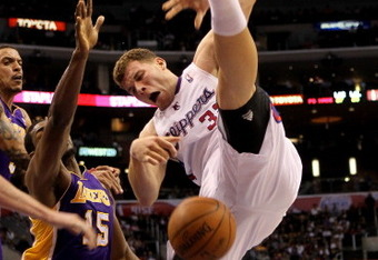LOS ANGELES, CA - DECEMBER 08:  Blake Griffin #32 of the Los Angeles Clippers falls to the florr after being fouled by Matt Barnes 9 (L) of the Los Angeles Lakers as Ron Artest #15 also defends at Staples Center on December 8, 2010 in Los Angeles, Califor