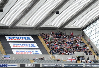 NEWCASTLE UPON TYNE, ENGLAND - AUGUST 28: Fulham fans look on from the top tier of the stadium during the Barclays Premier League match between Newcastle United and Fulham at St James' Park on August 28, 2011 in Newcastle upon Tyne, England.  (Photo by Ch