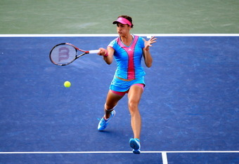 NEW YORK, NY - SEPTEMBER 05:  Andrea Petkovic of Germany returns a shot against  Carla Suarez Navarro of Spain during Day Eight of the 2011 US Open at the USTA Billie Jean King National Tennis Center on September 5, 2011 in the Flushing neighborhood of th