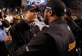 PITTSBURGH, PA - JANUARY 15:  (R-L) Head coach Mike Tomlin of the Pittsburgh Steelers speaks with head coach John Harbaugh of the Baltimore Ravens following the AFC Divisional Playoff Game at Heinz Field on January 15, 2011 in Pittsburgh, Pennsylvania. Th