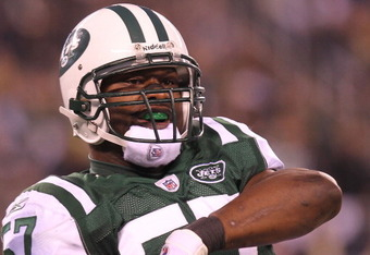 EAST RUTHERFORD, NJ - DECEMBER 12:  Bart Scott #57 of the New York Jets reacts the Miami Dolphins at New Meadowlands Stadium on December 12, 2010 in East Rutherford, New Jersey.  (Photo by Nick Laham/Getty Images)