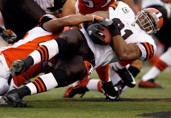 CINCINNATI - NOVEMBER 29:  Jamal Lewis #31 of the Cleveland Browns is tackled by Chris Crocker #42 of the Cincinnati Bengals during the NFL game at Paul Brown Stadium on November 29, 2009 in Cincinnati, Ohio.  (Photo by Andy Lyons/Getty Images)