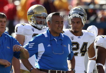TEMPE, AZ - NOVEMBER 26:  Offensive coordinator Norm Chow of the UCLA Bruins watches warm ups before the college football game against the Arizona State Sun Devils at Sun Devil Stadium on November 26, 2010 in Tempe, Arizona.  (Photo by Christian Petersen/