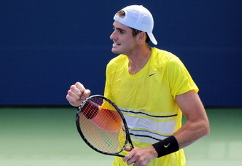NEW YORK, NY - SEPTEMBER 08:  John Isner of the United States reacts against Gilles Simon of France during Day Eleven of the 2011 US Open at the USTA Billie Jean King National Tennis Center on September 8, 2011 in the Flushing neighborhood of the Queens b