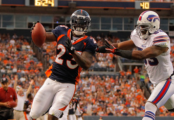 DENVER, CO - AUGUST 20:  Running back Willis McGahee #23 of the Denver Broncos beats linebacker Reggie Torbor #53 of the Buffalo Bills to the end zone for a touchdown in the second quarter at Sports Authority Field at Mile High on August 20, 2011 in Denve