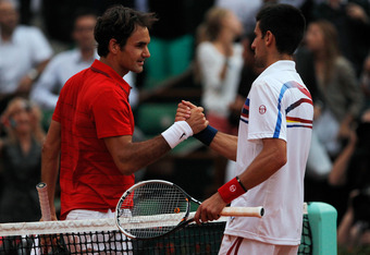 PARIS, FRANCE - JUNE 03:  Roger Federer of Switzerland is congratulated by Novak Djokovic of Serbia following his victory during the men's singles semi final match between Roger Federer of Switzerland and Novak Djokovic of Serbia on day thirteen of the Fr