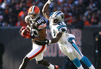 CLEVELAND - NOVEMBER 28:  Wide receiver Brian Robiskie #80 of the Cleveland Browns catches a pass in front of cornerback Captain Munnerlyn #41 of the Carolina Panthers at Cleveland Browns Stadium on November 28, 2010 in Cleveland, Ohio.  (Photo by Matt Su
