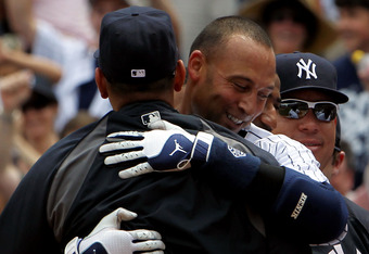 NEW YORK, NY - JULY 09:  Derek Jeter #2 of the New York Yankees celebrates at home with teammate Alex Rodriguez #13 after hitting a solo home run in the third inning for career hit 3000 while playing against the Tampa Bay Rays at Yankee Stadium on July 9,