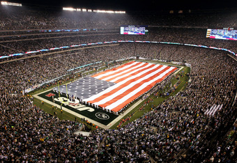 EAST RUTHERFORD, NJ - SEPTEMBER 13: The American flag waves duirng the national anthem prior to the New York Jets playing the Baltimore Ravens in their home opener at the New Meadowlands Stadium on September 13, 2010 in East Rutherford, New Jersey.  (Phot