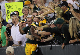 GREEN BAY, WI - SEPTEMBER 08:   Randall Cobb #18 of the Green Bay Packers celebrates after scoring a touchdown against the New Orleans Saints during the season opening game at Lambeau Field on September 8, 2011 in Green Bay, Wisconsin.  (Photo by Jonathan