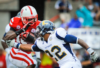 LINCOLN, NE - SEPTEMBER 03: Quincy Enunwa #18 of the Nebraska Cornhuskers tries to avoid Jordan Tippit #22 of the Chattanooga Mocs  during their game at Memorial Stadium September 3, 2011in Lincoln, Nebraska. Nebraska won 40-7. (Photo by Eric Francis/Gett