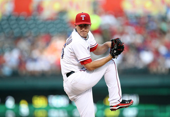 ARLINGTON, TX - AUGUST 05:  Derek Holland #45 of the Texas Rangers throws against the Cleveland Indians at Rangers Ballpark in Arlington on August 5, 2011 in Arlington, Texas.Texas Rangers  (Photo by Ronald Martinez/Getty Images)