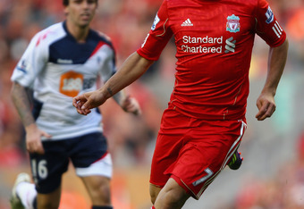 LIVERPOOL, ENGLAND - AUGUST 27:  Luis Suarez of Liverpool with the ball during the Barclays Premier League match between Liverpool and Bolton Wanderers at Anfield on August 27, 2011 in Liverpool, England.  (Photo by Clive Brunskill/Getty Images)