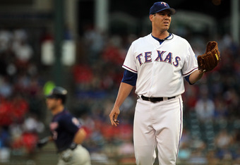 ARLINGTON, TX - JULY 27:  Colby Lewis #48 of the Texas Rangers steps off the mound after giving up a home run against Joe Mauer #7 of the Minnesota Twins at Rangers Ballpark in Arlington on July 27, 2011 in Arlington, Texas.  (Photo by Ronald Martinez/Get