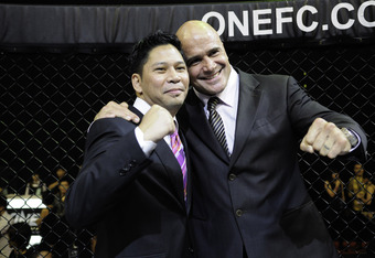 Rutten inside the One FC cage with CEO / Owner Victor Cui