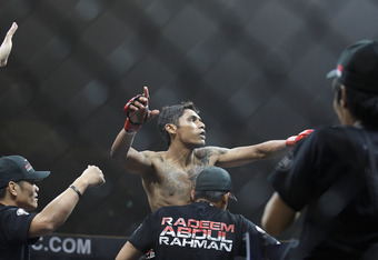 Singapore's first MMA fighter Radeem Rahman celebrates his win