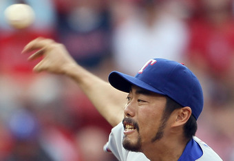 BOSTON, MA - SEPTEMBER 04:  Koji Uehara #19 of the Texas Rangers delivers a pitch in the ninth inning against the Boston Red Sox on September 4, 2011 at Fenway Park in Boston, Massachusetts.The Texas Rangers defeated the Boston Red Sox 11-4.  (Photo by El