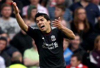 Luis Suarez calls for a handball penalty against Stoke